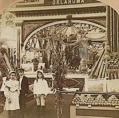 The Oklahoma exhibit with three children standing in the foreground.